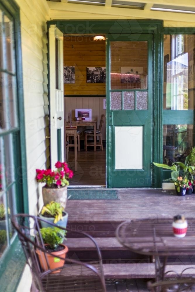 Cafe entrance with steps and open door - Australian Stock Image