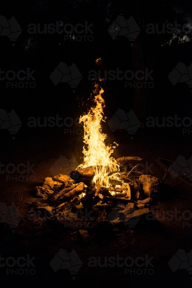 Camp fire at night - Australian Stock Image