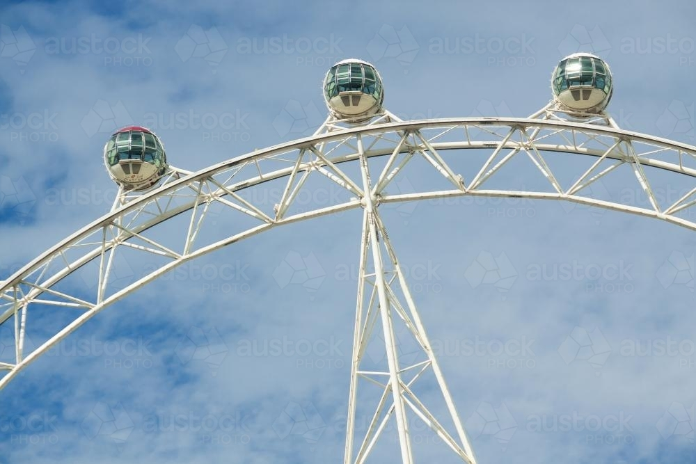 Capsules on a large ferris wheel, high in the sky - Australian Stock Image