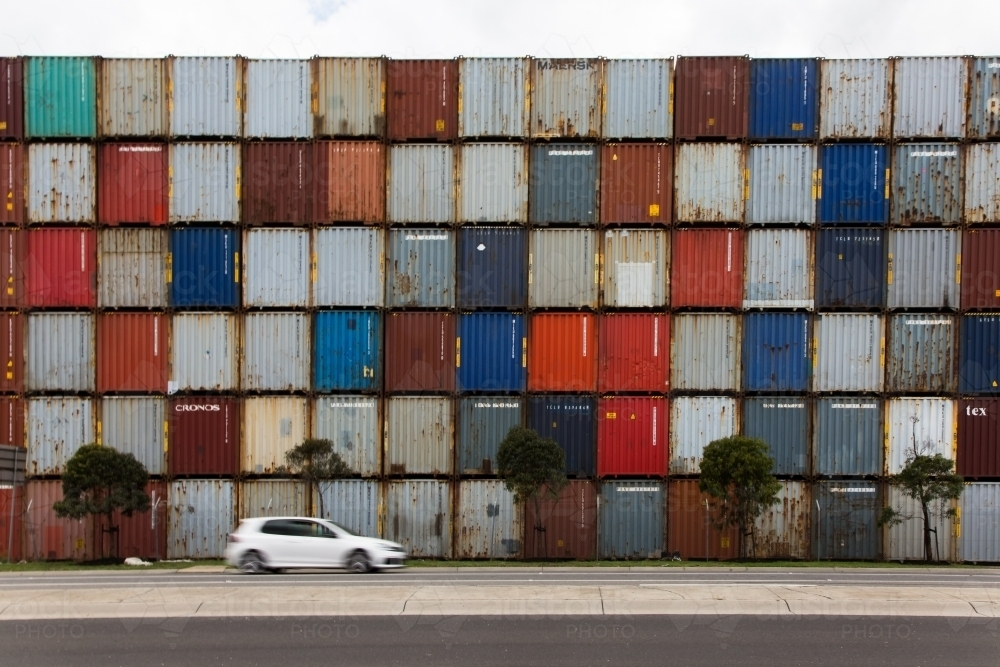 Car in front of colourful shipping containers - Australian Stock Image