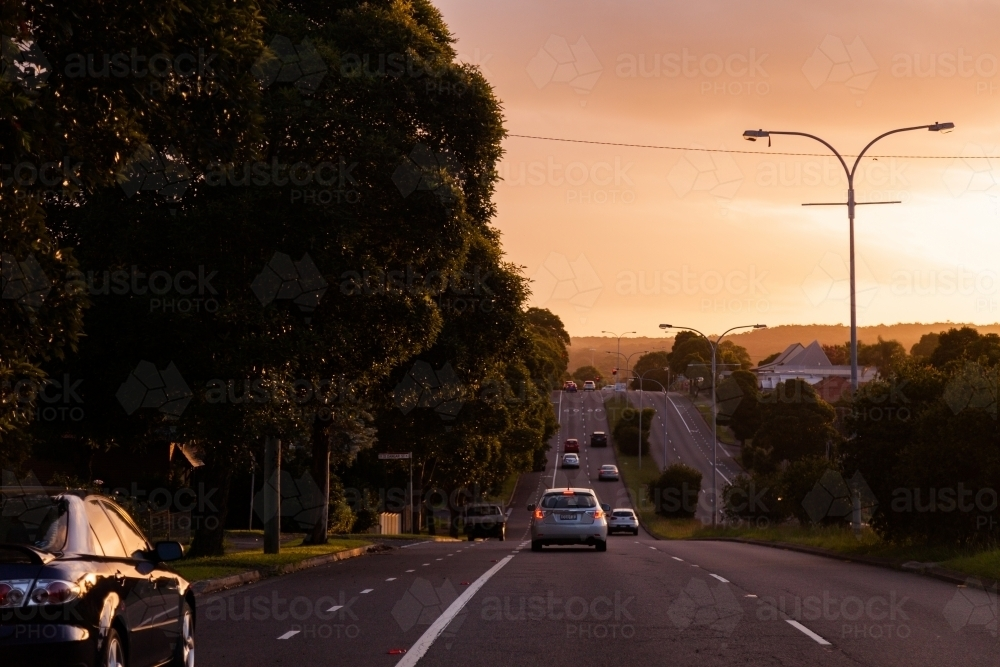Cars driving in low light conditions with hazardous visibility - Australian Stock Image