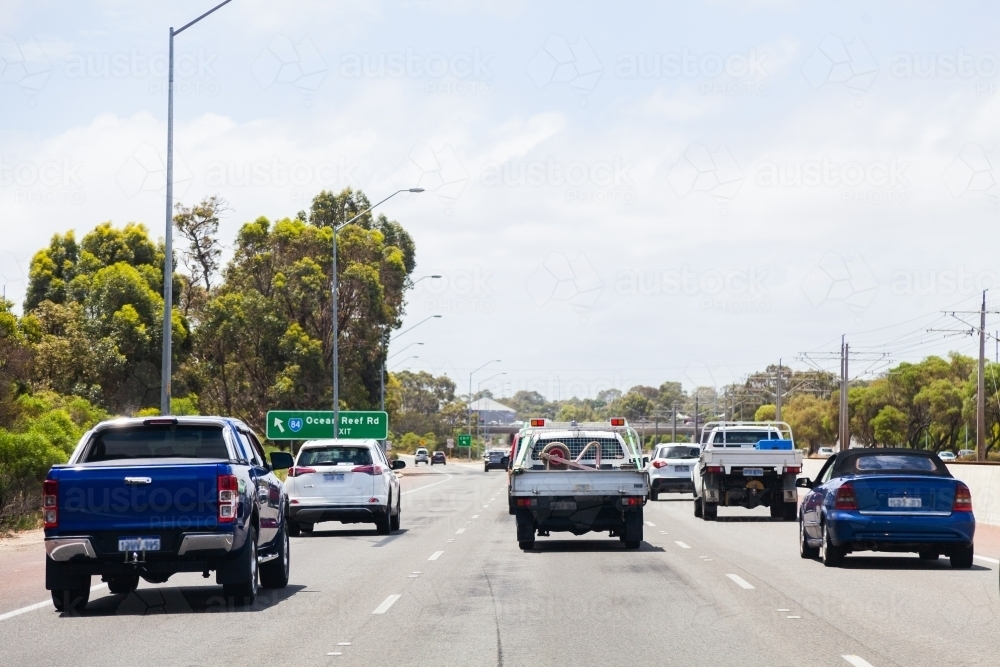 Cars driving on road with three lanes - Australian Stock Image