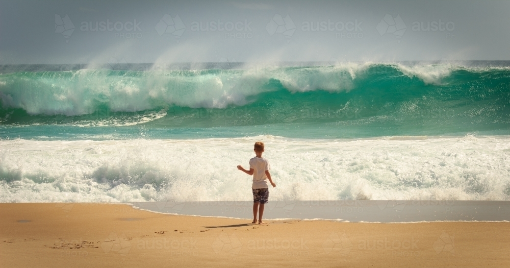 Child and waves at the beach, Yorke Peninsula, South Australia - Australian Stock Image