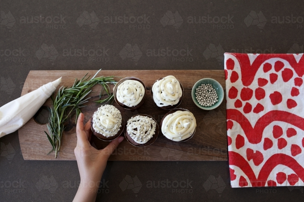 Chocolate cupcakes with white frosting - Australian Stock Image
