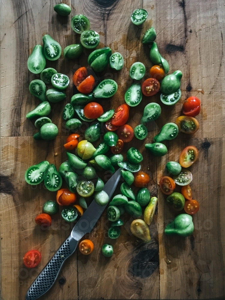 Chopped green and red tomatoes ready for making tomato relish - Australian Stock Image