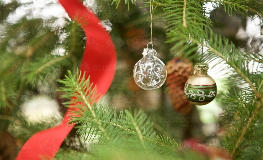 Christmas baubles and decorations hanging from trees - Australian Stock Image