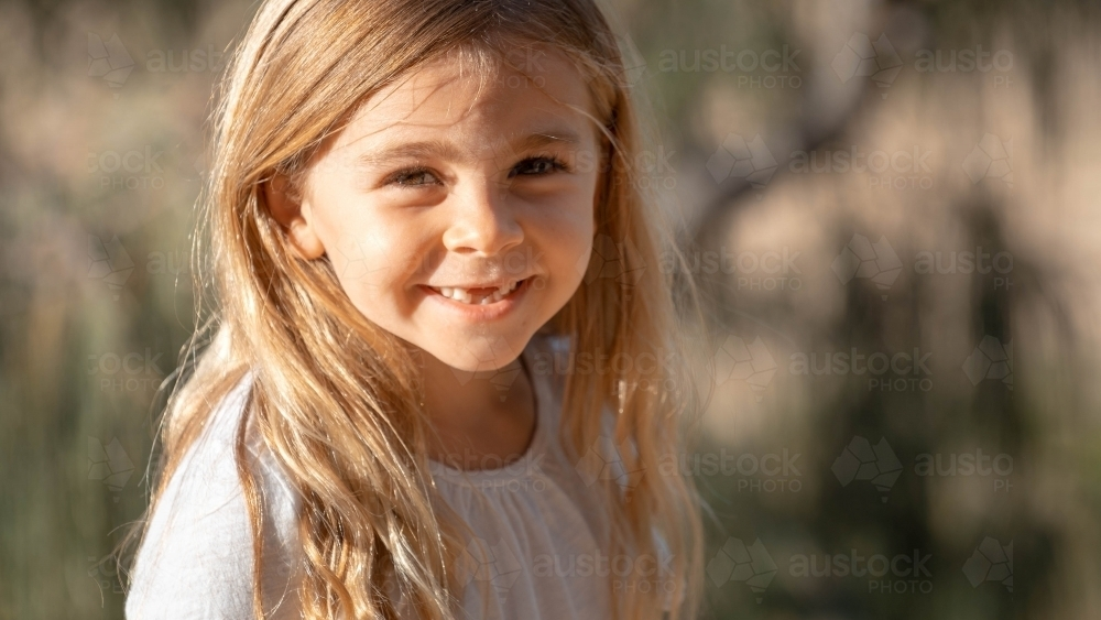Close of up young girl with front teeth missing - Australian Stock Image