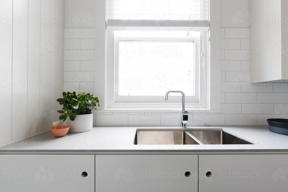Close up details of contemporary white apartment kitchen with subway tiles - Australian Stock Image