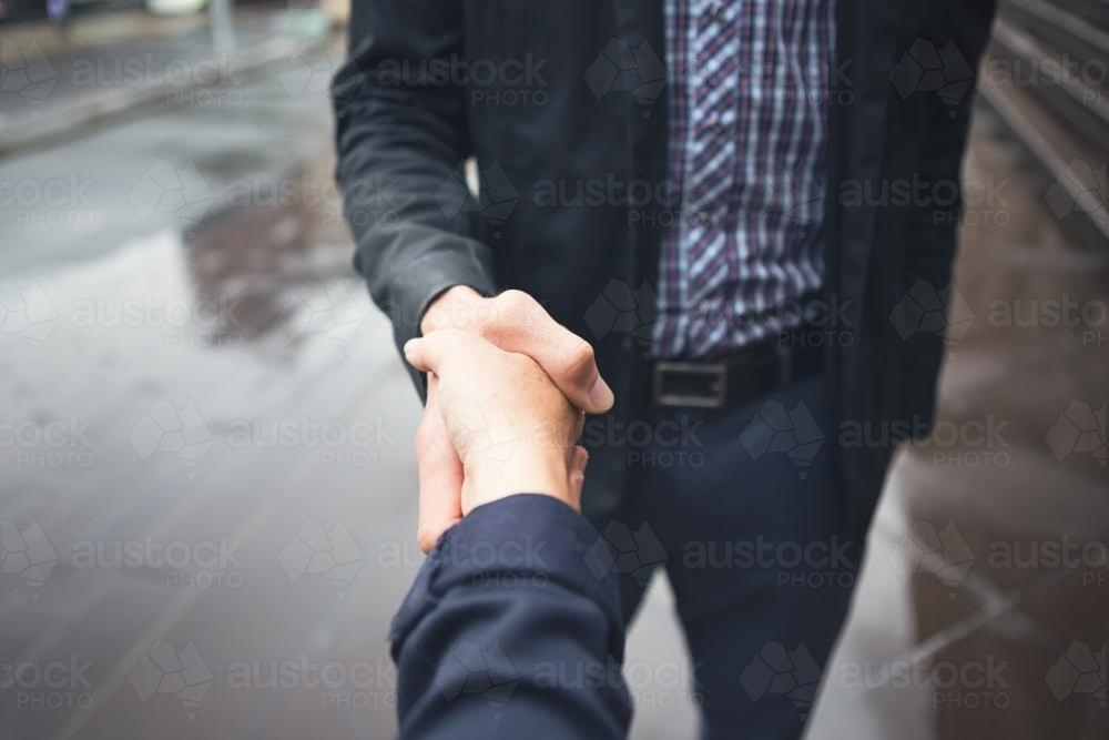 Close up handshake of guy in business casual dress - Australian Stock Image
