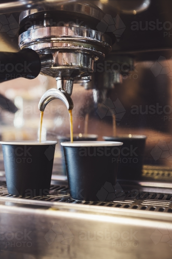 Close up of espresso machine making coffee in a cafe - Australian Stock Image