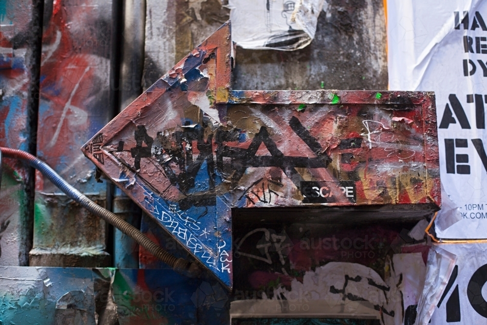 close up of graffiti covered arrow in Melbourne city - Australian Stock Image