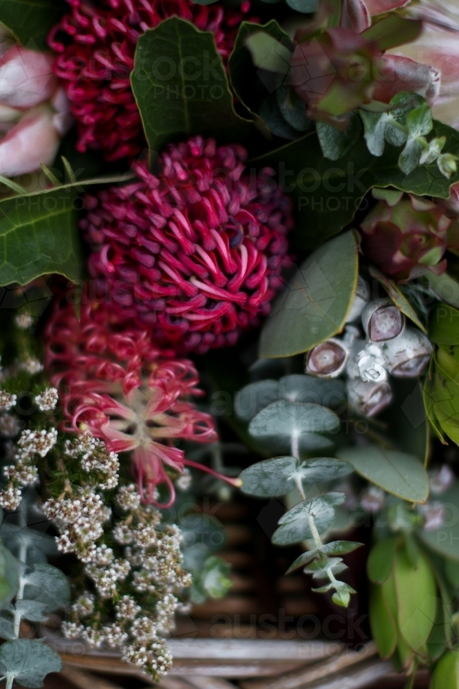Close up of native floral arrangement in a wicker basket - Australian Stock Image