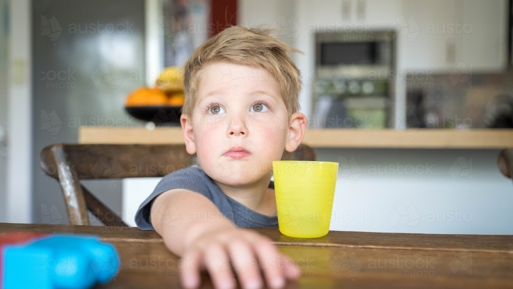 Close up of toddler with arm outstretched - Australian Stock Image