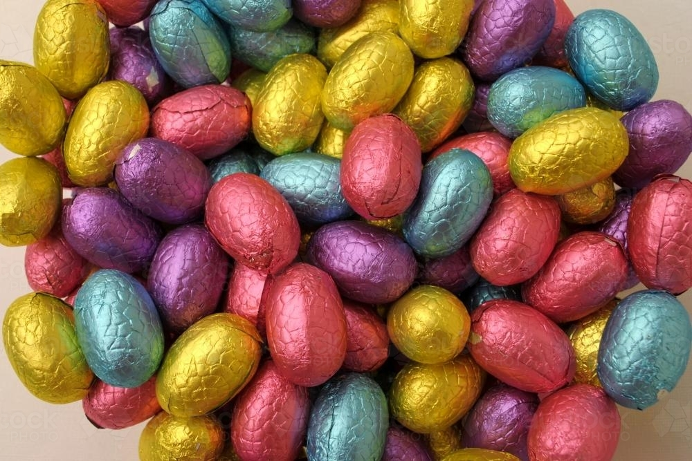 Close-up photo of chocolate Easter eggs in colourful foil - Australian Stock Image