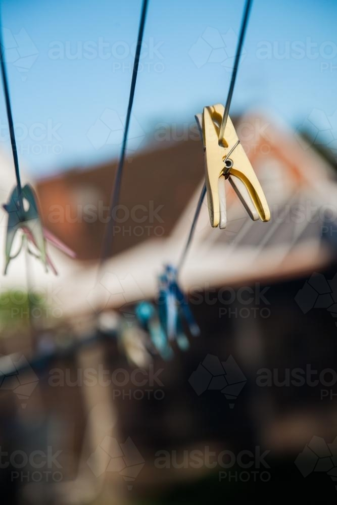 Clothes pegs on a drying line - Australian Stock Image
