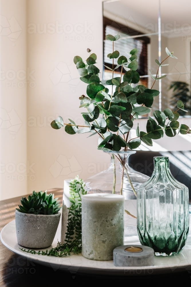 Collection of vases with greenery on a styled dining table - Australian Stock Image
