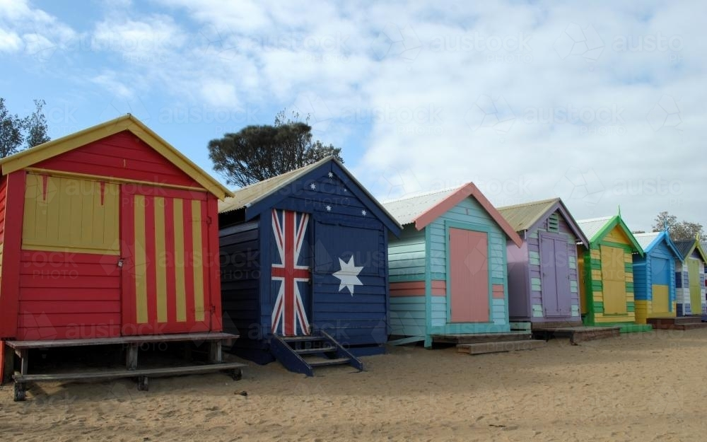 Colourful bathing boxes at Dendy Street Beach - Australian Stock Image