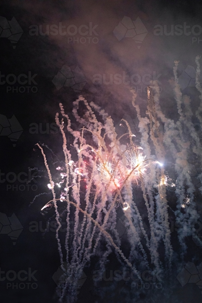 Colourful fireworks display in sky at night - Australian Stock Image