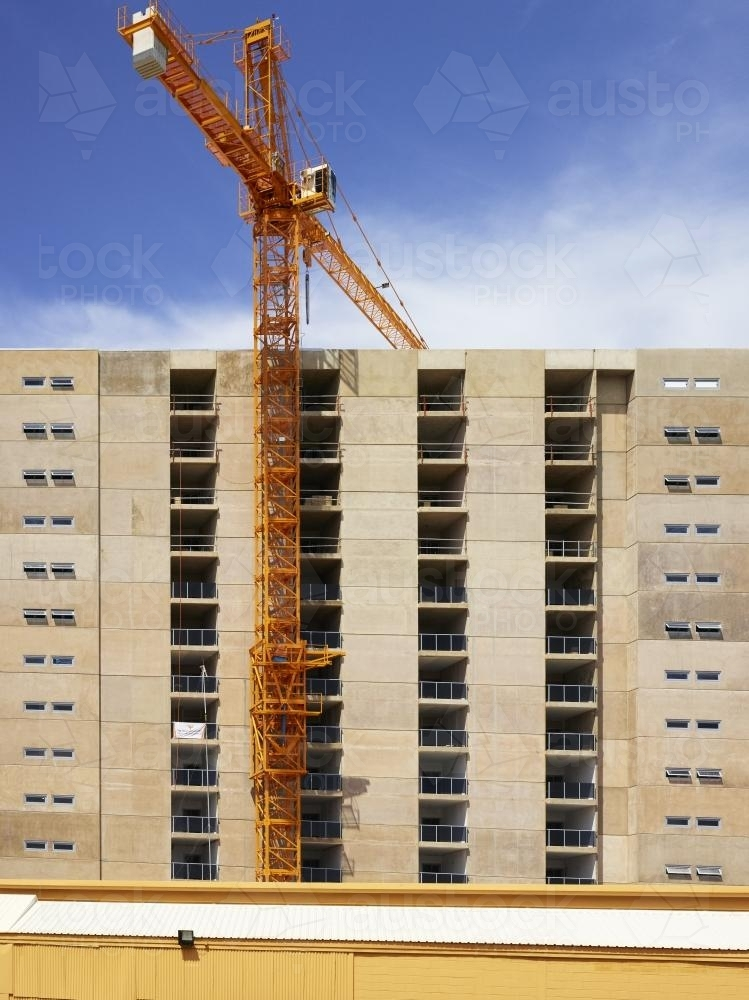Constructing a high-rise building with crane and blue sky - Australian Stock Image