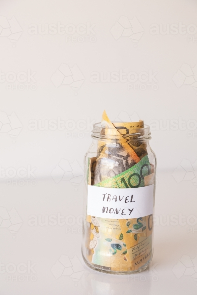 Copy space and jar of australian notes with travel money written on it - Australian Stock Image