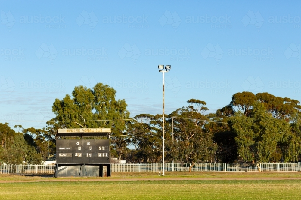 country football oval with scoreboard - Australian Stock Image