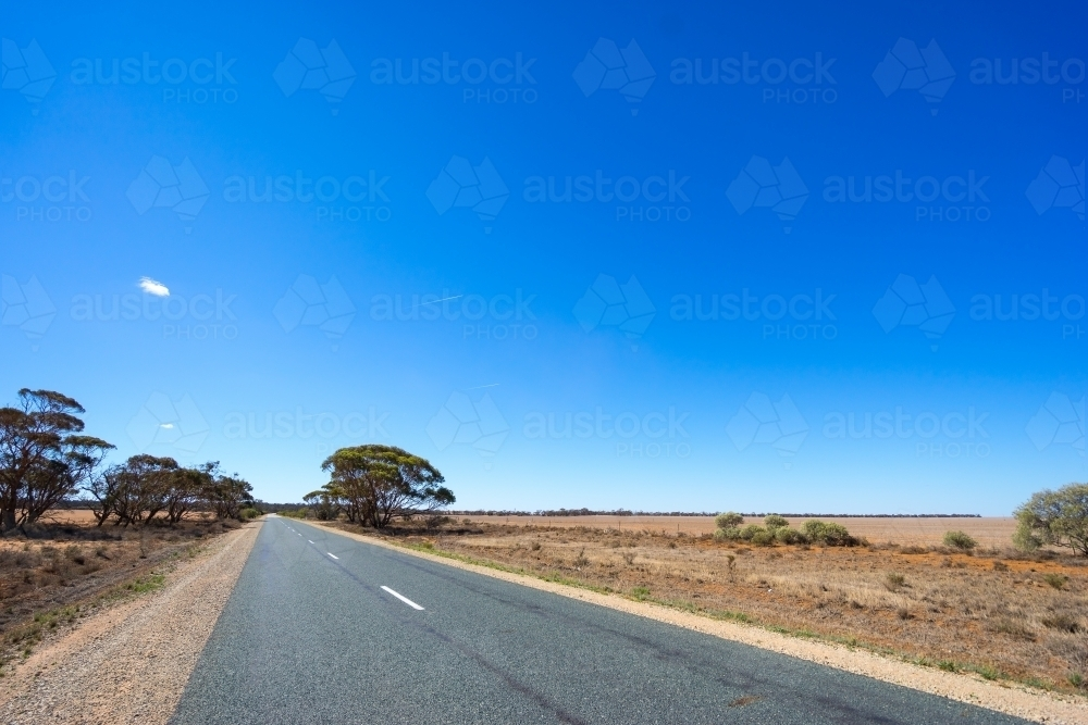 Country road and farm land - Australian Stock Image