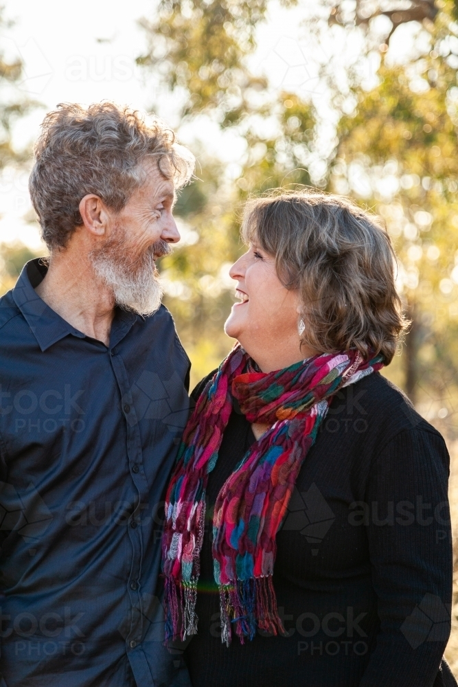 Couple standing together looking at each other - Australian Stock Image