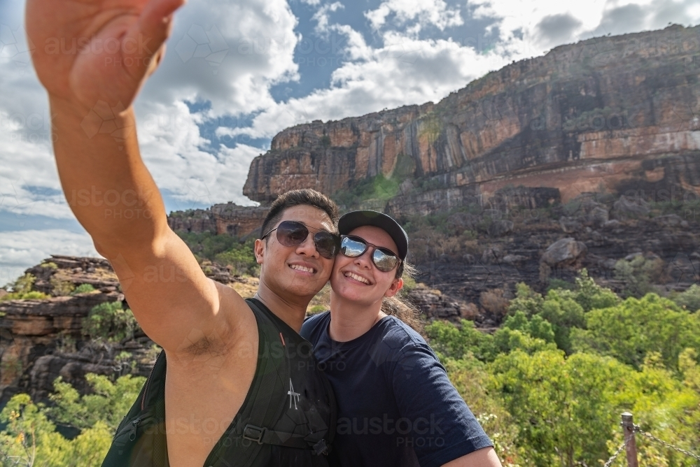 Couple taking selfies at Nourlangie, Kakadu - Australian Stock Image