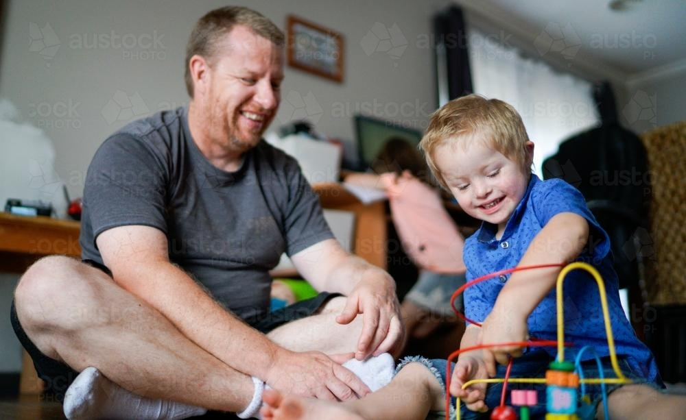 Dad with his Boy Playing on Floor - Australian Stock Image