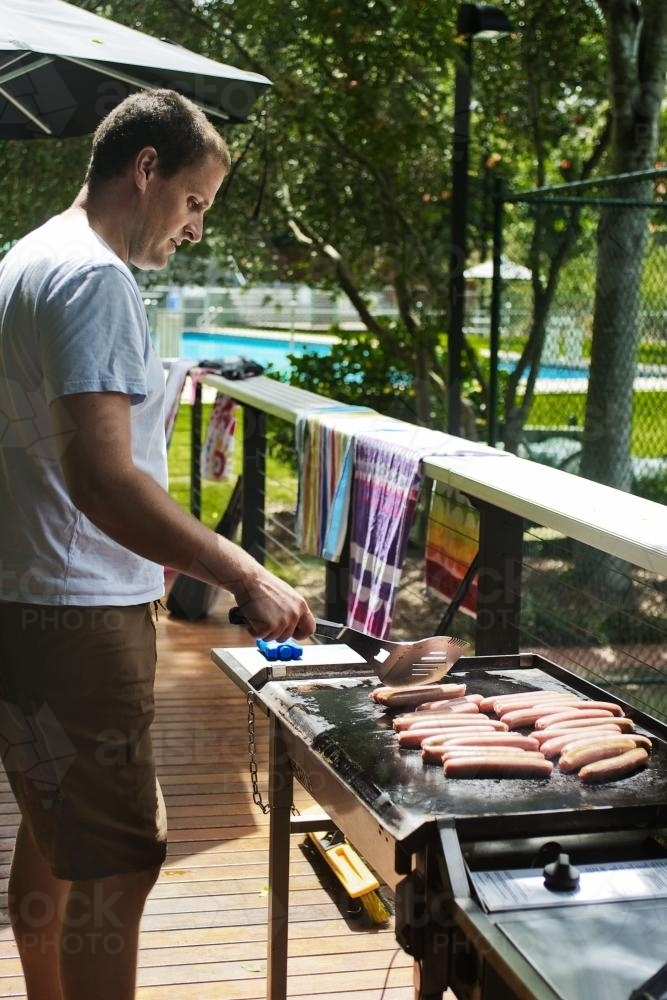 dad working the bbq - Australian Stock Image