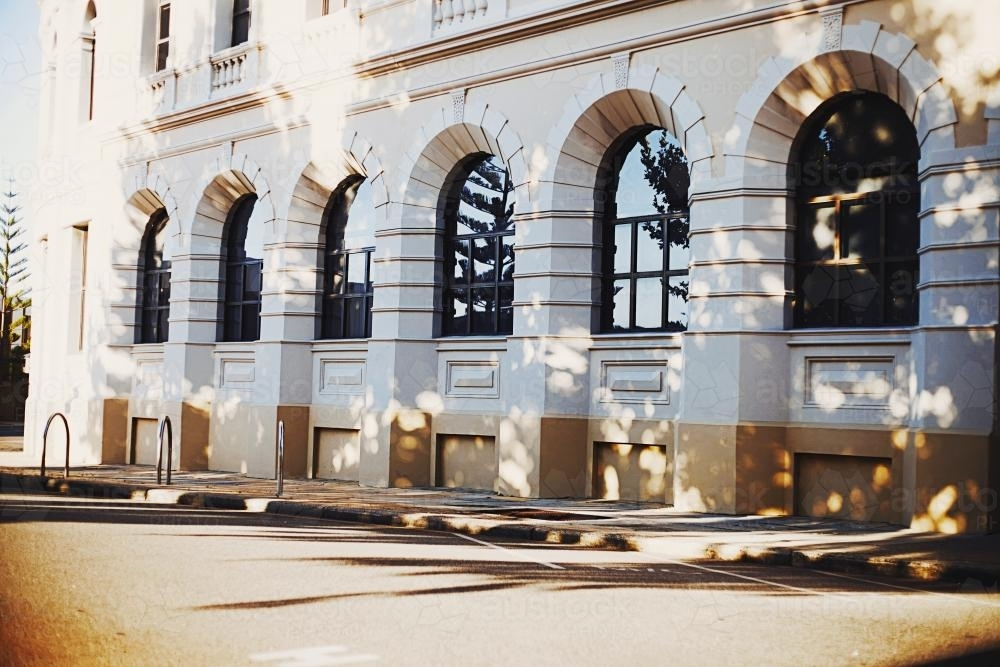 Dappled light on a grand old Fremantle building - Australian Stock Image