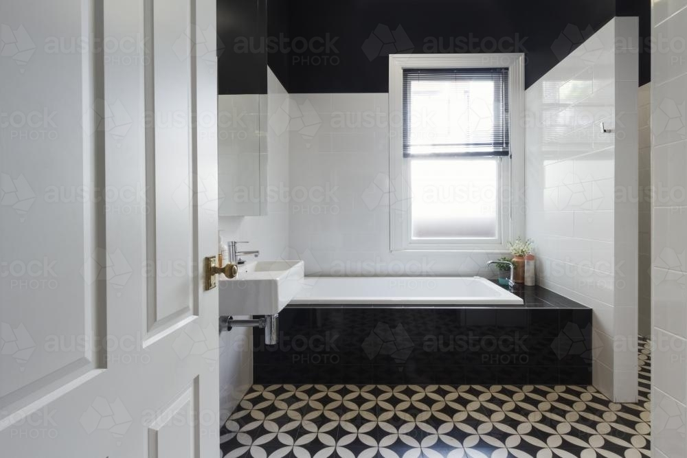 Image Of Designer Bathroom Renovation With Monochrome Moroccan Floor