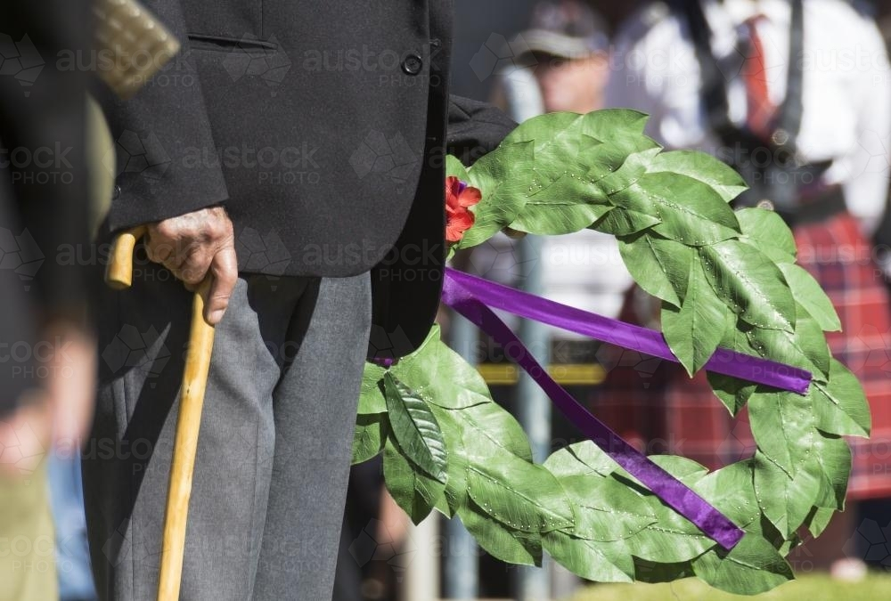 Detail of elderly male digger laying a wreath on ANZAC Day - Australian Stock Image