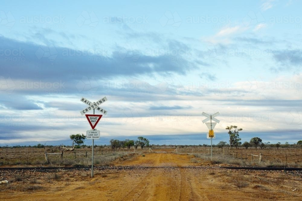 Dirt road railway crossing in remote location - Australian Stock Image
