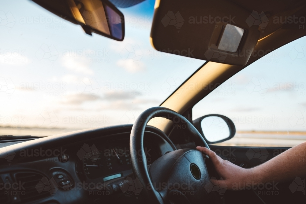 Driving a car into the sunset - Australian Stock Image