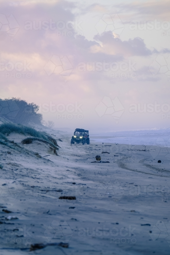 Dune buggies on South Stradbroke Island at dusk - Australian Stock Image