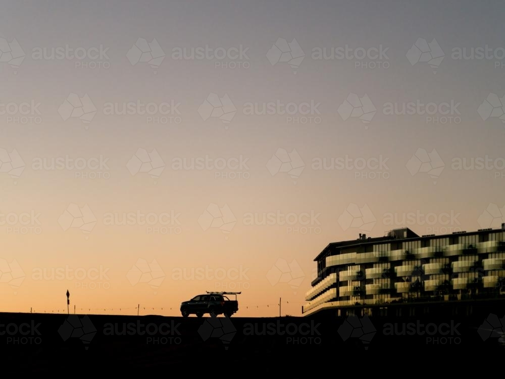 Dusk silhouette car and a hotel on Mt Panorama Racing Circuit - Australian Stock Image