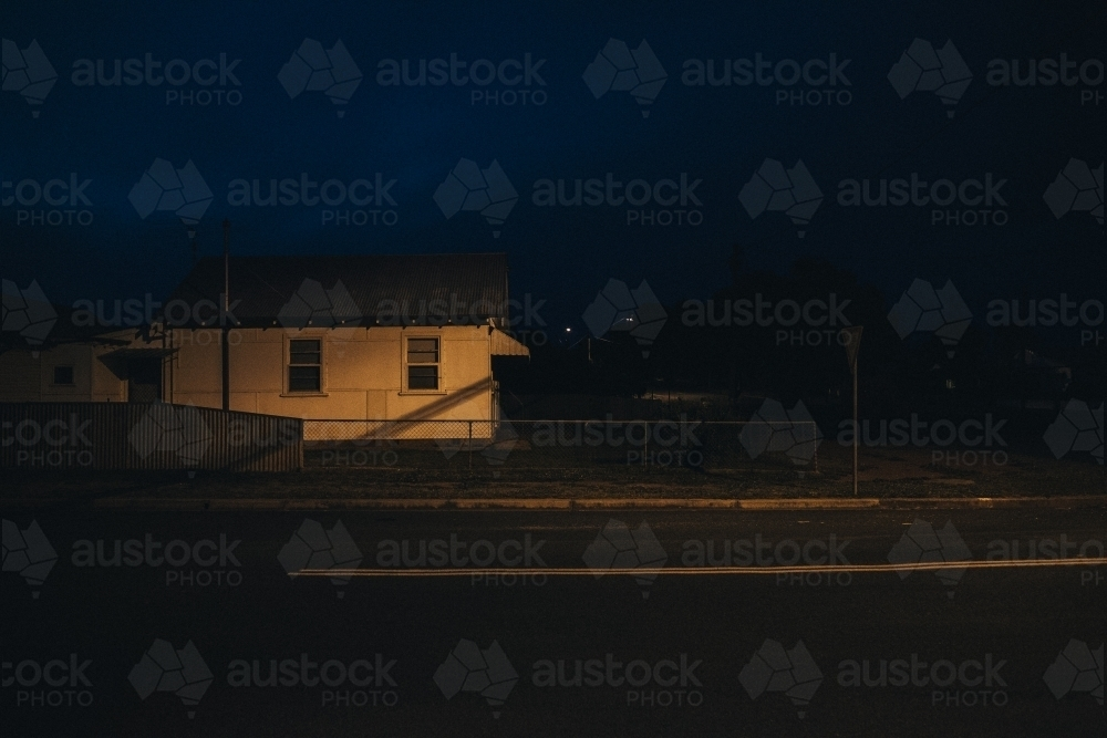 Early evening in regional town with house and street light - Australian Stock Image