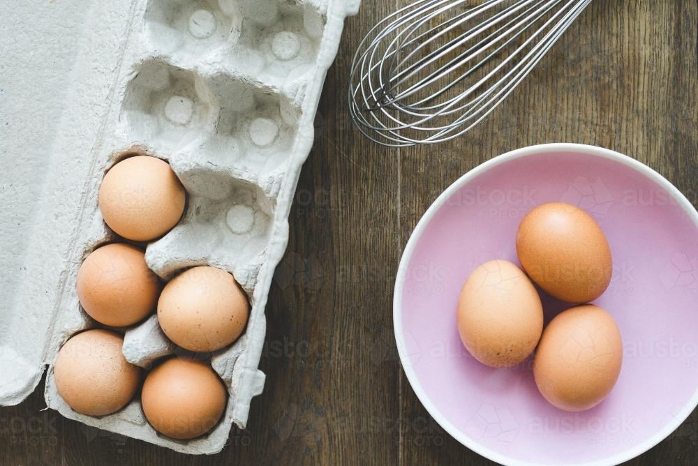 Eggs in a pink bowl - Australian Stock Image