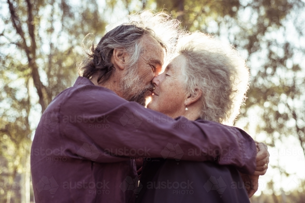 Elderly couple hug together - Australian Stock Image