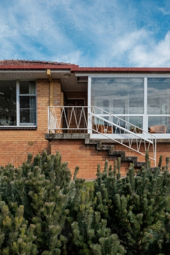 Elevated entrance of mid-century home - Australian Stock Image