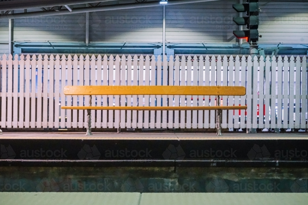 Empty bench at train station - Australian Stock Image
