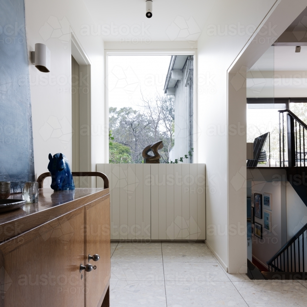 Entry foyer in designer mid century modern home interior - Australian Stock Image