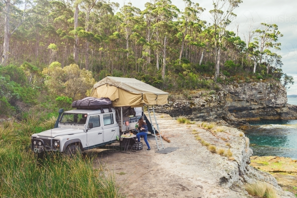 epic campsite on a ledge by the ocean, Bruny Island, Tasmania - Australian Stock Image