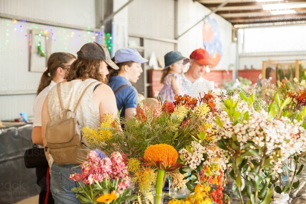 Family walking through pavilion looking at flower entries at local show - Australian Stock Image