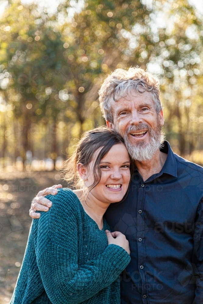 Father and adult daughter hug - Australian Stock Image