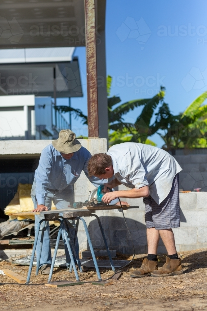 Father and son working - Australian Stock Image