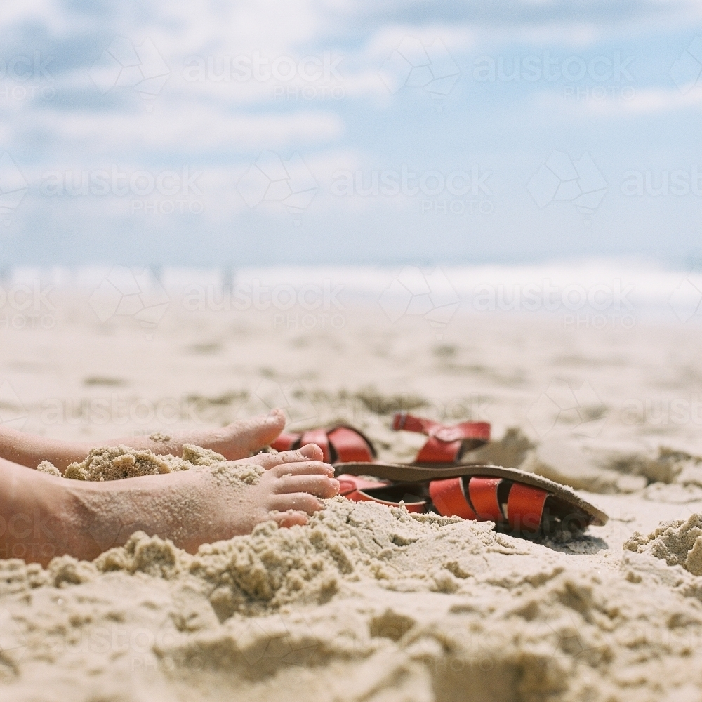 Feet in the sand at the beach - Australian Stock Image
