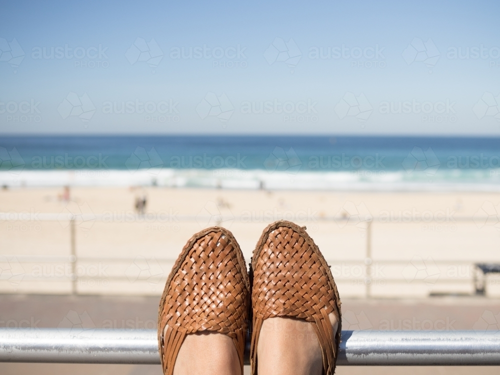 Feet resting whilst looking at the beach - Australian Stock Image