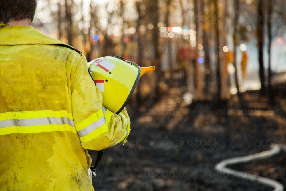 Fire and rescue man in fire brigade at grass fire emergency site - Australian Stock Image